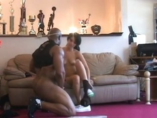 Black bodybuilder has sex with a petite white girl on the sofa