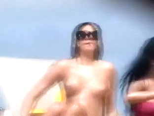 Pretty brunette smokes a cig on a nude beach in hidden cam clip