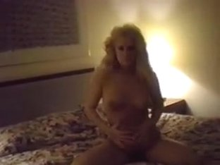 Pretty amateur blonde with full bush posing naked