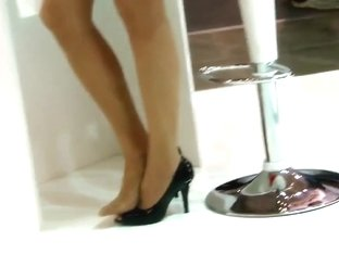 candid hostess pumps and stockinged footplay