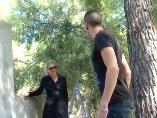 Mature blonde sucks dick in an abandoned building