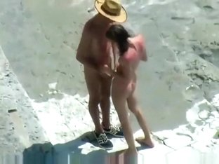 Voyeur tapes a skinny girl having a doggystyle quickie on a nude beach