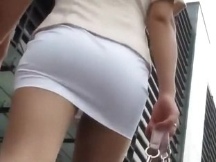 Classy chick got a tight butt under skirt