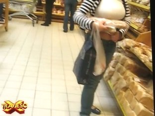 Booty babe gets filmed with a spy camera in a grocery store