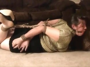 Sweet girl hogtied in clothes on the floor