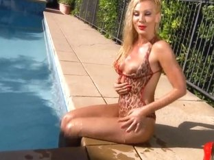 Sandy showing big wet ass and masturbating outside