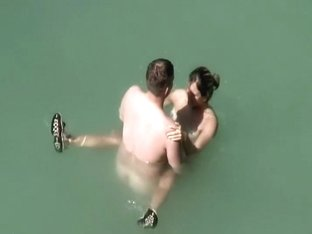 Voyeur notices they fuck in the water