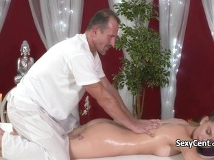 Oiled beauty fucks in massage room