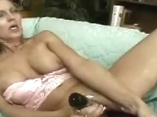 Stuffing my aged cunt with massive toys