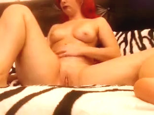 Ilaiza caresses her shaved pussy