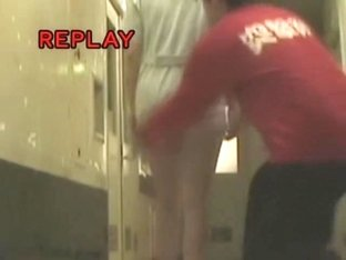 Man in red t-shirt sharking skirt of the cute nurse