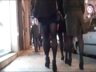 Group girls in skirt pantyhose and high heels