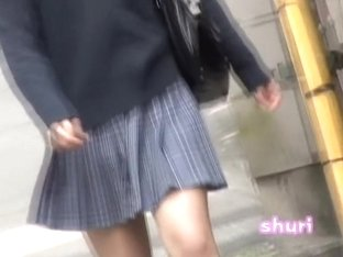 Attractive oriental schoolgirl gets interrupted on the street during sharking