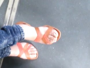 Teen with beautiful feet in the tramway