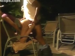 Ebony girl fucks on a chair on the terrace of her apartment building