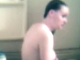 Pregnant wife taking a bath