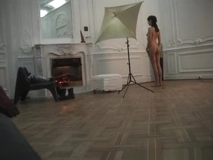Nude model posing for photographer
