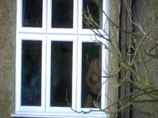 neighbour opening curtains