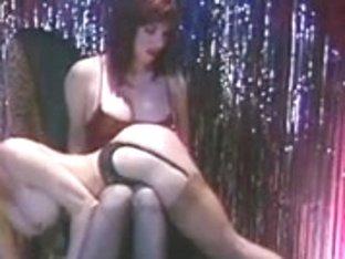 Dark Brown doxy spanks the golden-haired hottie's butt