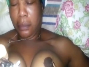 Haitian MILF loves cock between her tits