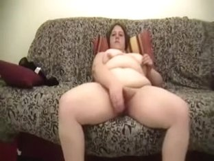 Busty and overweight older large alluring woman on the sofa reaches orgasm