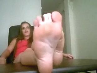 Charming brunette hair teases her hot feet on camera.