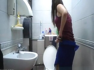 Teen seats in toilet to take a pee