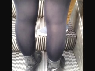 Sexy girl in very shiny black opaque tights