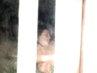 Female spied masturbating through the window of her bedroom