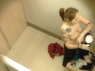 Topless tattooed Asian babe changing in dressing room