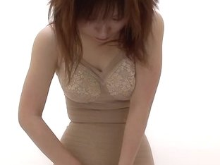 Lingerie changing room spy cam shows a topless Asian girl