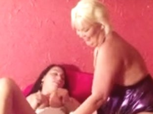 Mature lesbian using a hot teen girl