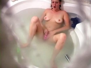Busty babe fingering her twat
