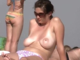 Sexy topless views on a beach