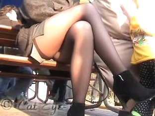 Public upskirt of the blonde with crossed legs in stockings