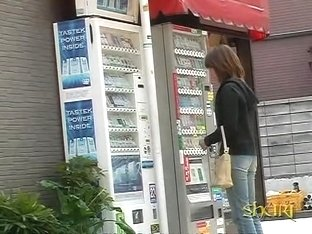 Vending machine Shuri sharking scene of beautiful Asian brunette