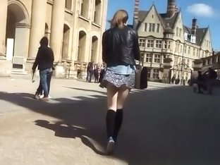 Wind lifts teen short skirt and exposes her ass