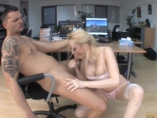 Busty blonde sucks cock in the office in HD video