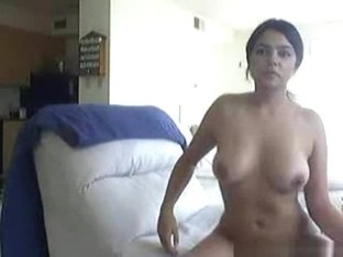 Dark haired hot latina girl plays with her pussy on the sofa