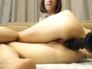 Babe with big bust has a toy in ass