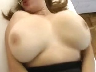 Busty and curvaceous white housewife in mask and sexy dress