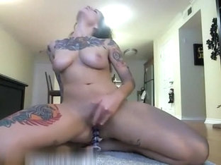 Tattooed chick playing with her pussy