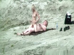 Nude couple fucking in the rocks