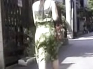 Japanese street sharking video showing a provocative lady
