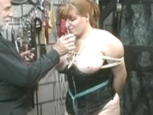 Cute thick bondman beauty in corset is restrained and abased by her slavemaster