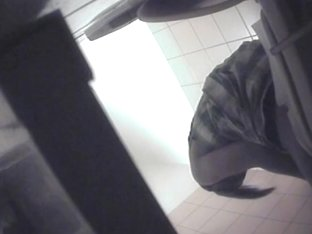 Sexy wench in a dress exposing her ass on toilet camera