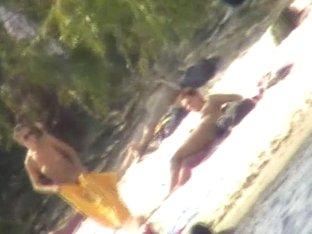 Voyeur's camera filmed naked woman on the beach