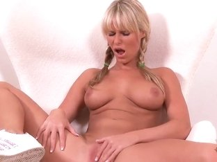 Sexy blonde with pigtails and beautiful skin Sandra Hill carefully masturbates