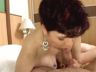 A gorgeous GILF sucks a young stud's wang