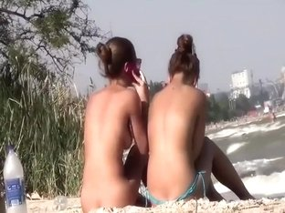 Peeping two seductive tanned girls